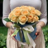 25 cream roses in a hat box